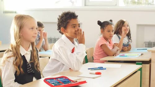 Students Sit a Desk in Classroom and Listen Carefully To the Teacher