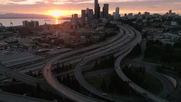 Thumbnail for Sunset Aerial Of Interstate 5 In Seattle Washington With Puget Sound And Olympic Mountain Range