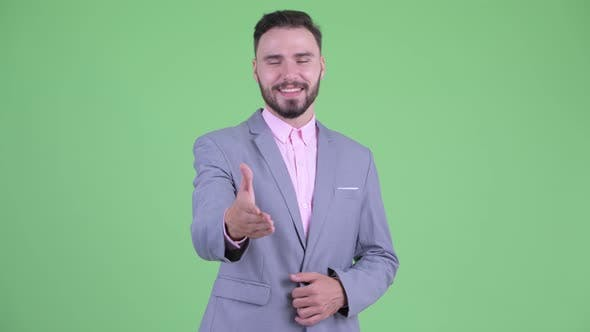 Cover Image for Happy Young Handsome Bearded Businessman Giving Handshake