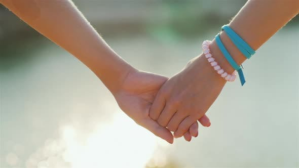 Thumbnail for Two Woman Tenderly Hold Hands Romantic Couple