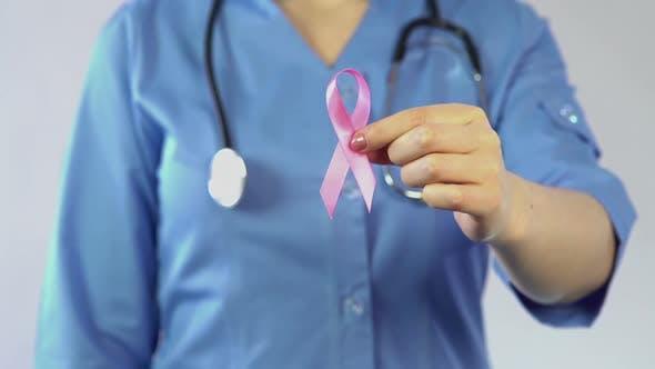 Thumbnail for Female Doctor Holding Pink Ribbon, International Breast Cancer Awareness Symbol