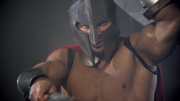 Thumbnail for Spartan Hiding From Rain Under Shield