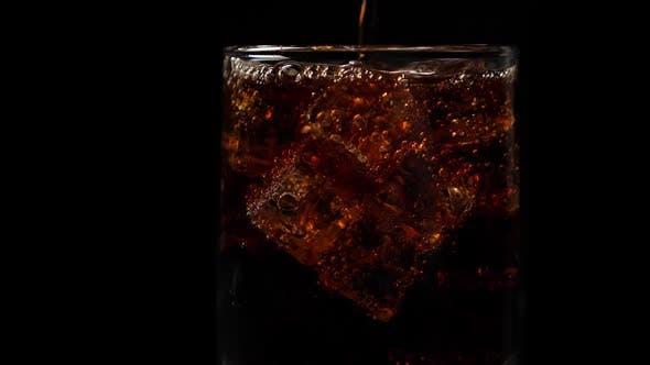 Pouring Coca Cola Into the Glass