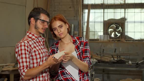 Thumbnail for Professional Male Carpenter Talking To His Female Assistant
