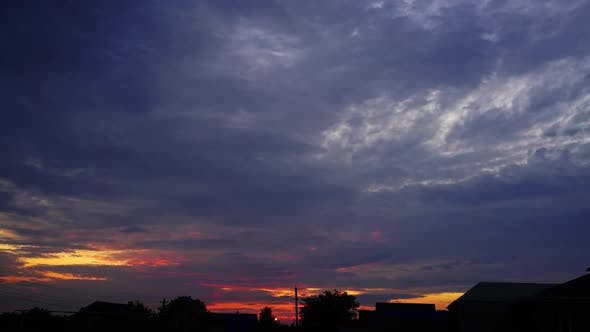 Thumbnail for Timelapse with Sunset Sky Over Houses Village