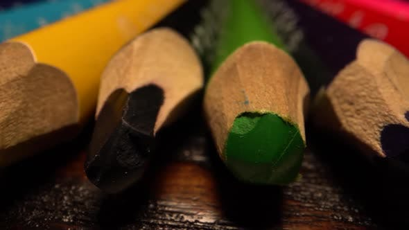 Many Colored Pencils Lie in Row. Sliding Over Pencils on Table. Macro Shot on Laowa Lens.
