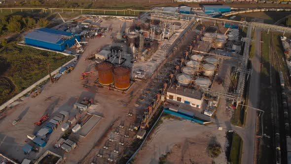 Aerial View. Industrial Area with Factories and Rail Freight Line. Factories, Freight Trains and