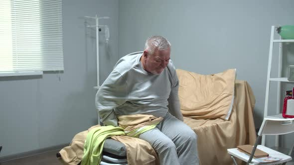 Thumbnail for Doctor Help Old Man To Sit in a Wheelchair in Hospital