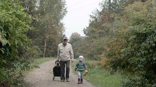 Grandad And Grandson Walking