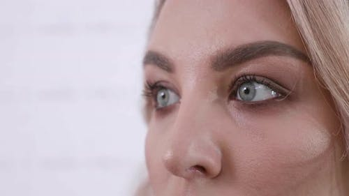 Beautiful Young Woman with Blue Eyes Made Her Makeup in a Beauty Salon