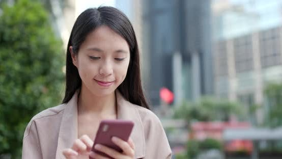 Thumbnail for Young Woman Working on Cellphone at Outdoor
