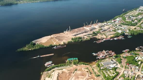 Thumbnail for Construction Site on the River Bank, View From the Copter. Barge Sails Between the Banks, Houses on