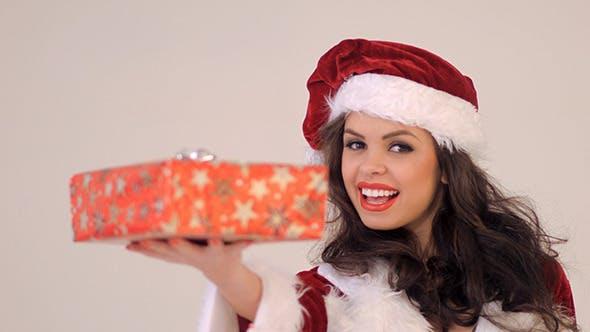 Thumbnail for Portrait Of Smiling Brunette Holding Gift Box