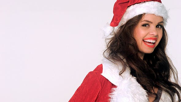 Thumbnail for Smiling Girl in Santa Claus Costume Posing