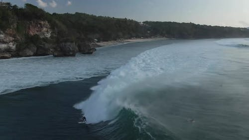 Aerial View Of Group Of Surfers In Ocean In Bali, Indonesia