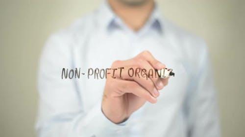 Non-Profit Organization, Businessman Writing on Transparent Screen