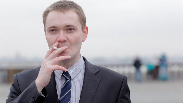 Thumbnail for Businessman Thinking While Smoking A Cigarette