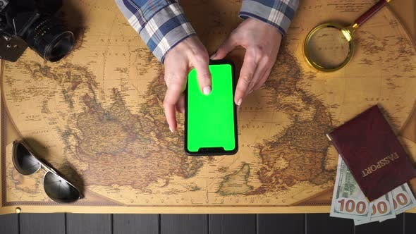 Thumbnail for Traveler Uses a Smartphone, Top View