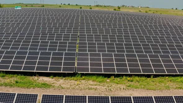 Thumbnail for Aerial Drone View. Solar Power Plant Farm in Summer. Production of Clean Energy.