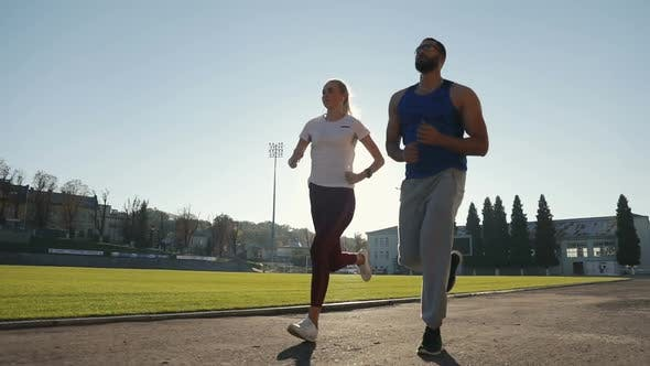 Thumbnail for Couple of Joggers in Stadium