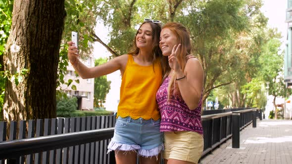 Thumbnail for Teen Girls Taking Selfie By Smartphone in Summer
