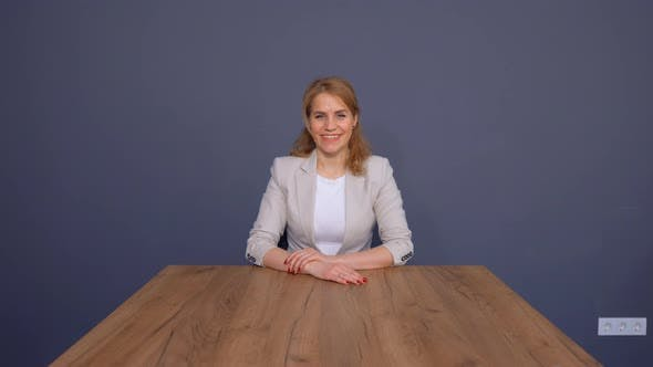 Cover Image for Mature Businesswoman Sitting in Office