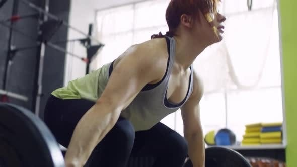 Thumbnail for Female Weightlifter Doing Barbell Snatch