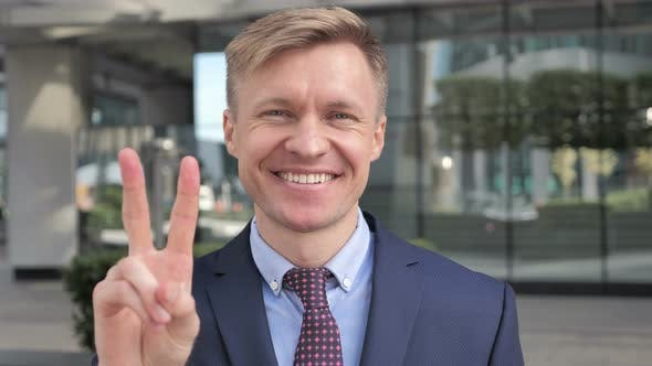 Thumbnail for Victory Sign by Businessman