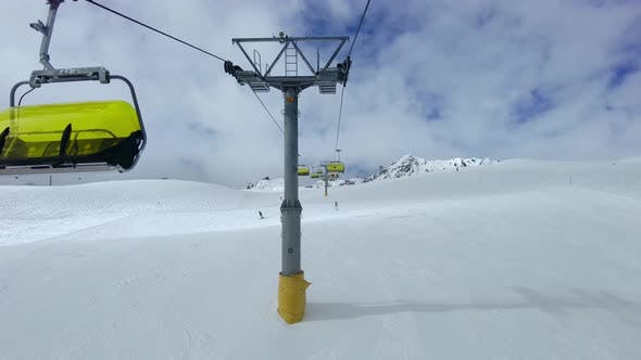 Chair Lifts In Action In Ski Areas In The Swiss Alps