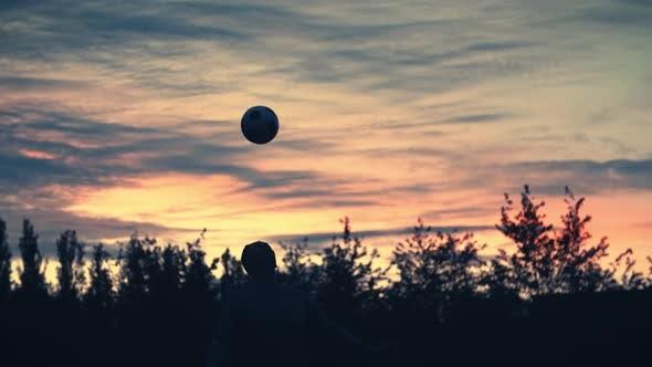 Thumbnail for Sunset Soccer Silhouette Header Slow Motion