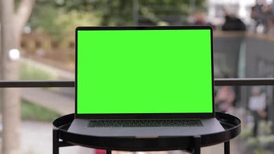 Close Up Mock-up Green Screen MacBook Pro Laptop Standing on Table