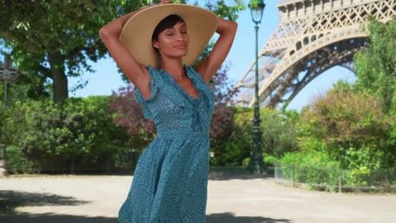 Thumbnail for African woman enjoying Paris atmosphere in front of Eiffel Tower outside