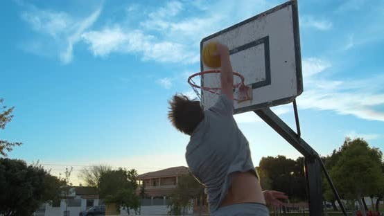 Thumbnail for Street Basketball. The Player Scores the Ball in the Basket