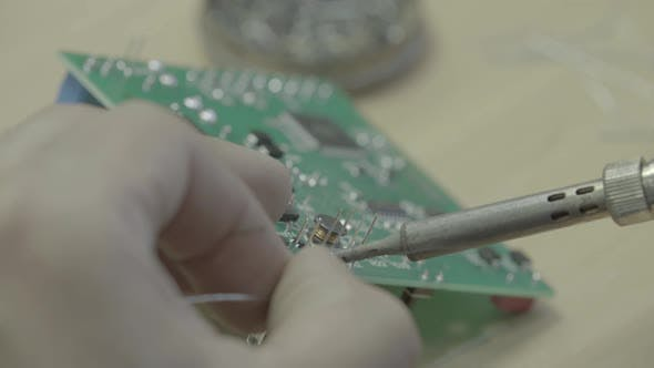 Thumbnail for A Worker Is Working on the Production of an Electronic Board. Close-up.