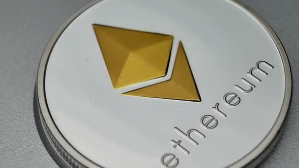 Cover Image for Ethereum ETH Coins Rotating on Bills of Euro