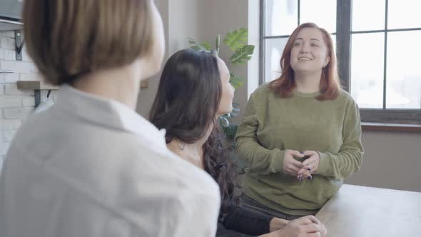 Thumbnail for Charming Plussize Redhead Woman Listening To Friend Talking at Front and Smiling