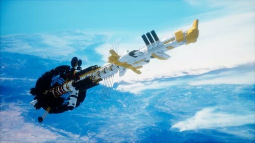 Futuristic Spaceship Near the Earth. Elements of This Image Furnished By NASA