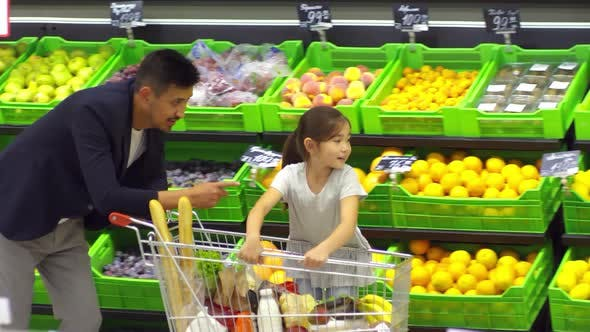 Thumbnail for Cheerful Girl Shopping for Food with Father