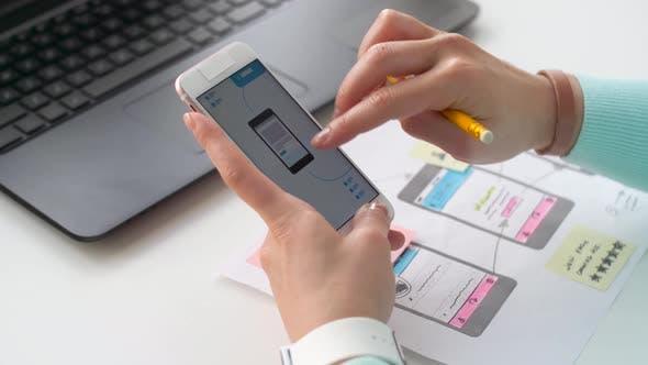 Thumbnail for Designer Working on Smartphone Interface Design 11