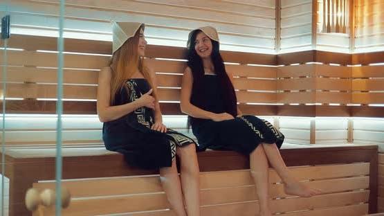 Girls Relax in the Sauna