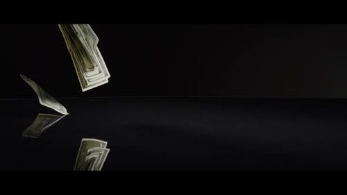 American $100 Bills Falling onto a Reflective Surface - MONEY 0014