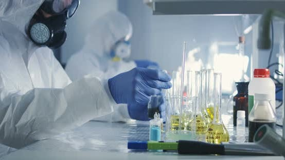 Thumbnail for Scientists Working in Laboratory