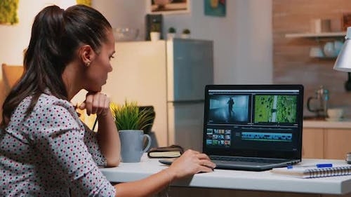 Videographer Editing From Home on Professional Laptop