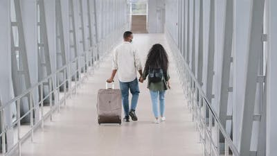 Two Young People in Love Traveling Together