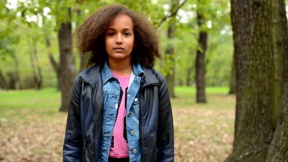 Thumbnail for Young African Girl Stand in the Forest and Stare in To the Camera - Eye Contact
