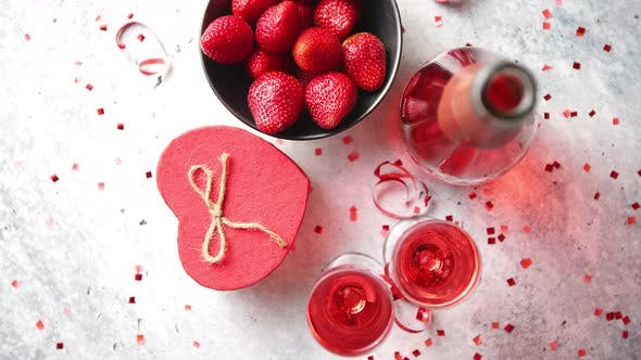 Thumbnail for Bottle of Rose Champagne, Glasses with Fresh Strawberries and Heart Shaped Gift