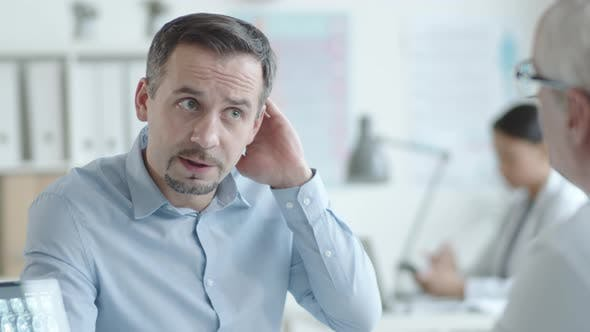 Thumbnail for Man Complaining of Headache to Senior Practitioner