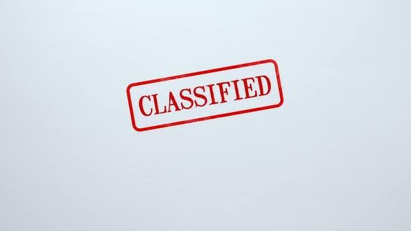 Thumbnail for Klassifiziertes Siegel auf blankem Papierhintergrund gestempelt