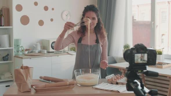 Thumbnail for Female Vlogger Checking Density of Dough