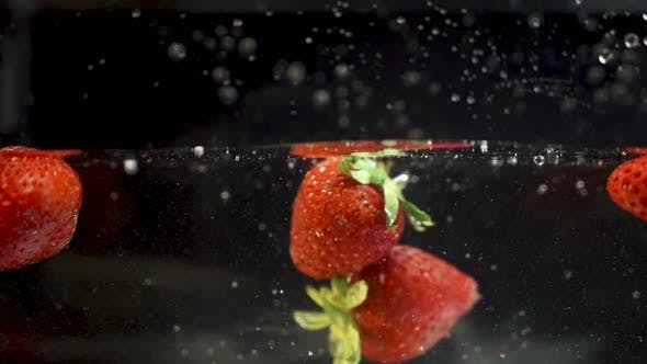 Cover Image for Strawberry Hitting Another One when Falling in The Water
